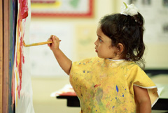 Girl in classroom painting